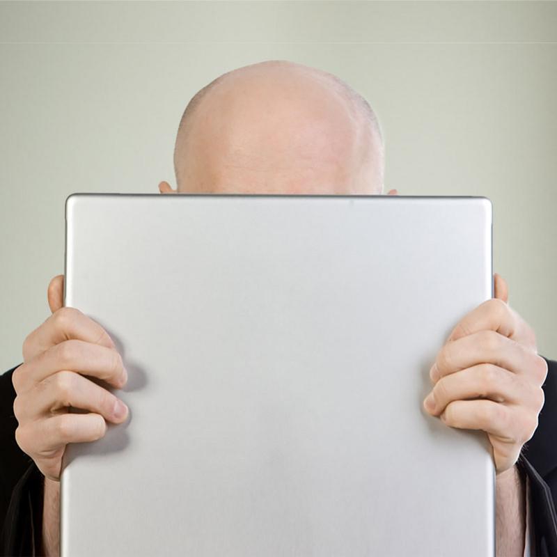 Boris Etchin behind his laptop